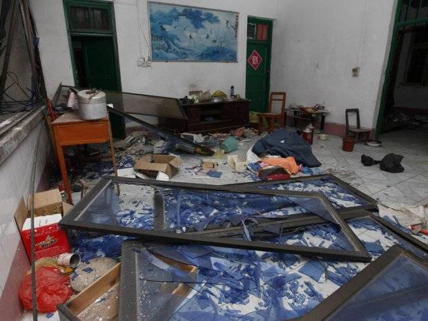 Damaged windows are seen on the ground of a room at the site of blasts in Liucheng county in Liuzhou in south China's Guangxi province on September 30, 2015. Three people were killed on September 30 by multiple explosions in southern China, state media said, with local reports saying that the blasts occurred in 13 locations including government offices.   CHINA OUT   AFP PHOTO / STRSTR/AFP/Getty Images