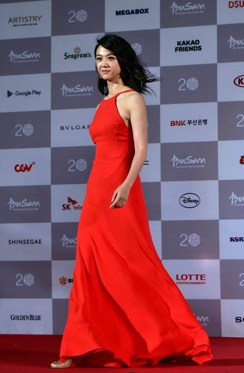 Chinese actress Tang Wei walks on the red carpet for the opening ceremony of the Busan International Film Festival (BIFF) at the Busan Cinema Center in Busan on October 1, 2015. Stars from Asia and beyond gathered in South Korea's second largest city on October 1 for a Bollywood-flavoured launch of the 20th Busan International Film Festival. This year's BIFF will screen 304 movies from 75 countries, including 94 world premieres, a number of them produced by the rising stars of Asian cinema. AFP PHOTO / JUNG YEON-JE