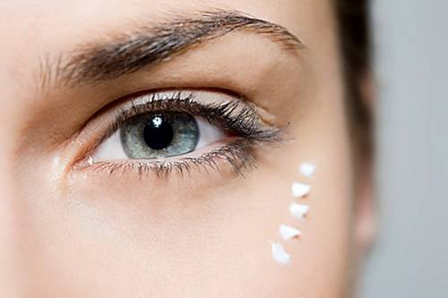 Woman with eye cream