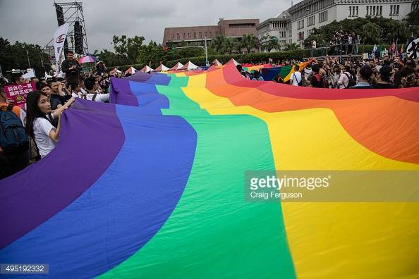 TAIPEI, TAIWAN - 2015/10/31: The rainbow flag, a symbol of gay rights, leads off the annual LGBT pride march. Upwards of 60 000 people took to the streets of Taipei for the annual Pride march, the largest such event in Asia. Taiwan is often said to be the likeliest Asian nation to legalize gay marriage. (Photo by Craig Ferguson/LightRocket via Getty Images)