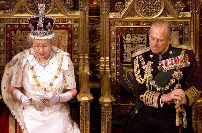 LONDON, UNITED KINGDOM - NOVEMBER 17:  Britain's Queen Elizabeth II gives her speech during the State Opening of Parliament beside her husband Prince Philip 17 November 1999 in the House of Lords. The queen made her opening speech in which she outlined what her goverment proposes to introduce to parliament and marks the opening of the session.  (ELECTRONIC IMAGE)  (Photo credit should read JONATHAN UTZ/AFP/Getty Images)