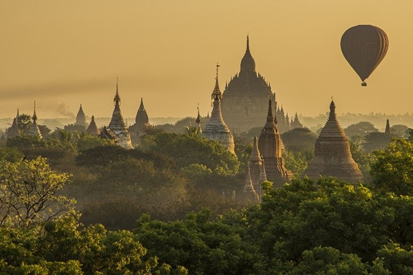 Bagan Balloons at sunrise, Myanmar. This is one of my favorite photos, the complexity of the temples with that one single balloon, it's almost unreal.