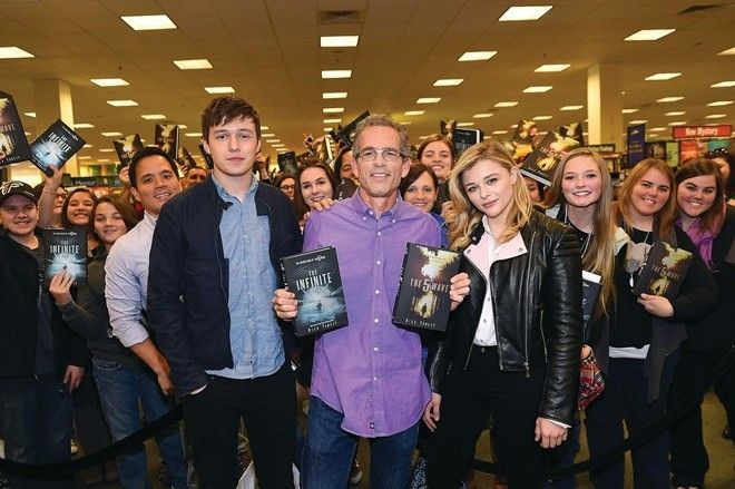 "NEWNAN, GA - DECEMBER 07:  (EXCLUSIVE COVERAGE) Nick Robinson, Rick Yancey, and Chloe Grace Moretz with fans attend ""The 5th Wave"" Book & Movie Promotion at Barnes and Noble, The Forum at Ashley Park on December 7, 2014 in Newnan, Georgia.  (Photo by Paras Griffin/Getty Images)"