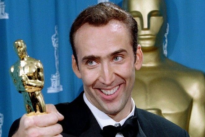 """Actor Nicolas Cage gives holds his Oscar statuette after winning an Academy Award as best actor for his role in """"Leaving Las Vegas"""" at the 68th Academy Awards telecast in Los Angeles, March 25 - RTXGW45"""