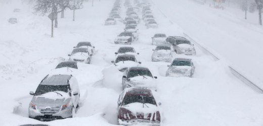 Hundreds of cars are seen stranded on Lake Shore Drive Wednesday, Feb. 2, 2011 in Chicago. A winter blizzard of historic proportions wobbled an otherwise snow-tough Chicago, stranding hundreds of drivers for up to 12 hours overnight on the city's showcase lakeshore thoroughfare and giving many city schoolchildren their first ever snow day. (AP Photo/Kiichiro Sato)