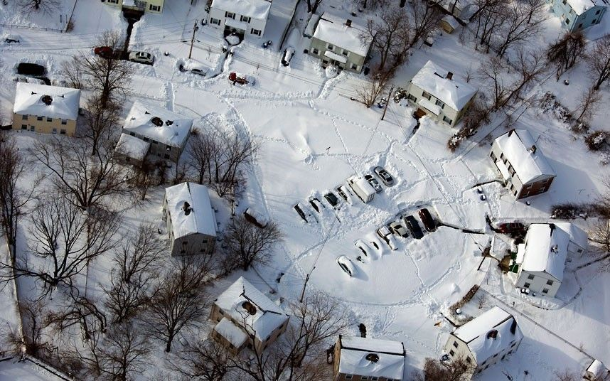 16 Cars and houses in a southwest Connecticut neighbourhood are covered in snow