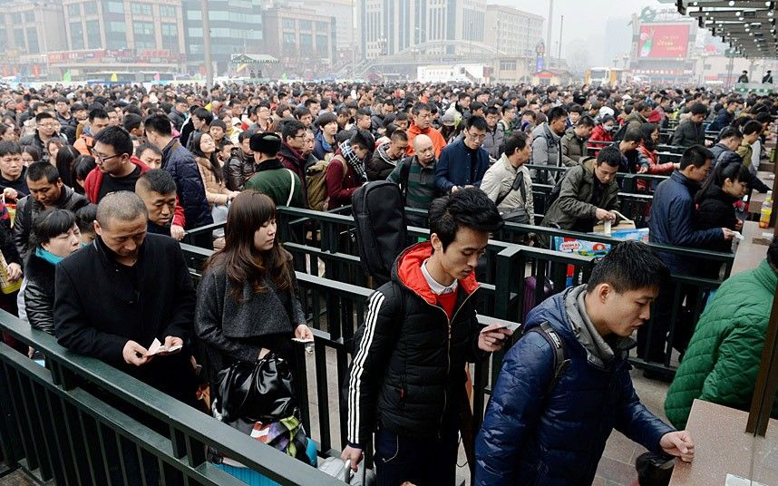 Mandatory Credit: Photo by Imaginechina/REX (4434659c)  Crowds of passengers flock into Beijing Railway Station  Travel rush ahead of the Chinese New Year, China - 16 Feb 2015  Planes, trains, automobiles, even motorcycles, whatever the transport option, it's bursting at the seams. Hundreds of millions of mainland Chinese are now embarking on the world's largest annual human migration, squeezing in up to 2.8 billion trips to visit friends and family over the Lunar New Year holiday. Official government figures predict 2.4 billion road, 295 million rail and 47.5 plane journeys will be taken over the 40-day travel rush between February 4 and March 16.