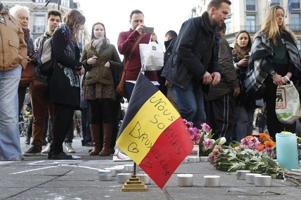 People gather around a memorial in Brussels following bomb attacks in Brussels, Belgium