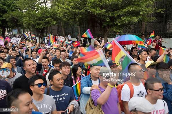 TAIPEI, TAIWAN - 2015/10/31: Large crowds carrying signs and waving rainbow flags came out to show their support for gay rights at the LGBT Pride celebration. Upwards of 60 000 people took to the streets of Taipei for the annual Pride march, the largest such event in Asia. Taiwan is often said to be the likliest Asian nation to legalize gay marriage. (Photo by Craig Ferguson/LightRocket via Getty Images)
