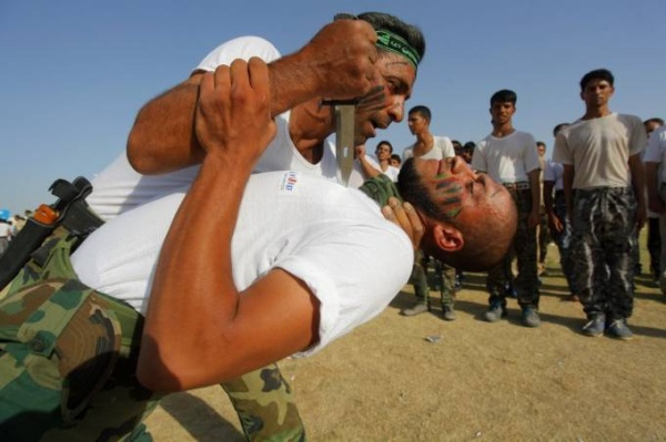 like-the-ypg-iraqs-shia-militias-are-one-of-the-major-ground-forces-fighting-isis-here-members-of-a-militia-demonstrate-close-quarter-combat-skills-at-a-graduation-ceremony