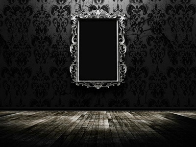 a beautiful vintage mirror in a dark room