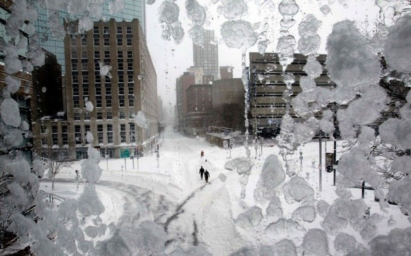 21 People walk through snow-covered Copley Square during a blizzard in Boston, Massachusetts