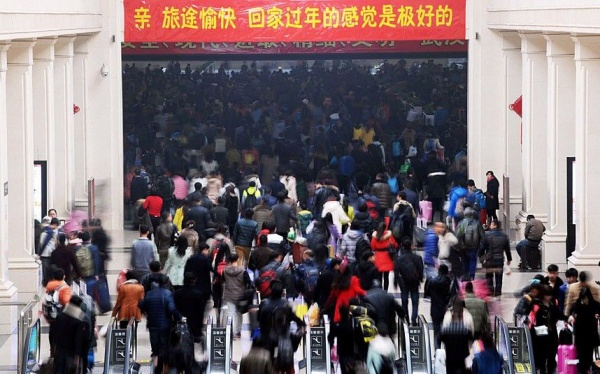 Mandatory Credit: Photo by Imaginechina/REX (4434659e)  Crowds of passengers flock into Hankou Railway Station in Wuhan city, Hubei province  Travel rush ahead of the Chinese New Year, China - 16 Feb 2015  Planes, trains, automobiles, even motorcycles, whatever the transport option, it's bursting at the seams. Hundreds of millions of mainland Chinese are now embarking on the world's largest annual human migration, squeezing in up to 2.8 billion trips to visit friends and family over the Lunar New Year holiday. Official government figures predict 2.4 billion road, 295 million rail and 47.5 plane journeys will be taken over the 40-day travel rush between February 4 and March 16.