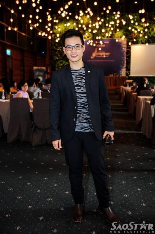 Hà Anh bảnh bao với bộ vest tối màu. The Master of Symphony là chương trình nghệ thuật do công ty của anh tổ chức.