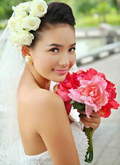 Phan Như Thảo mặc váy cô dâu trong một bộ phim truyền hình.