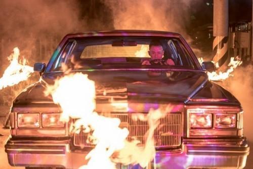 Cảnh quay mạo hiểm khi Lâm Phong ngồi trong xe ô tô bị cháy.