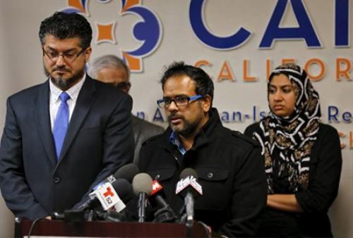 Anh rể của Syed Farook là Farhan Khan (giữa) bàng hoàng với tin hắn giết người  - Ảnh: Reuters