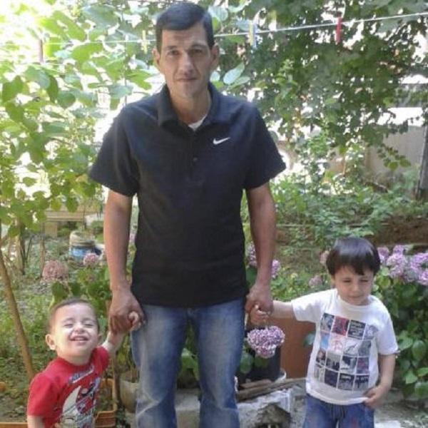Bức ảnh hạnh phúc của anh Abdullah Kurdi và 2 con. Ảnh: Reuters