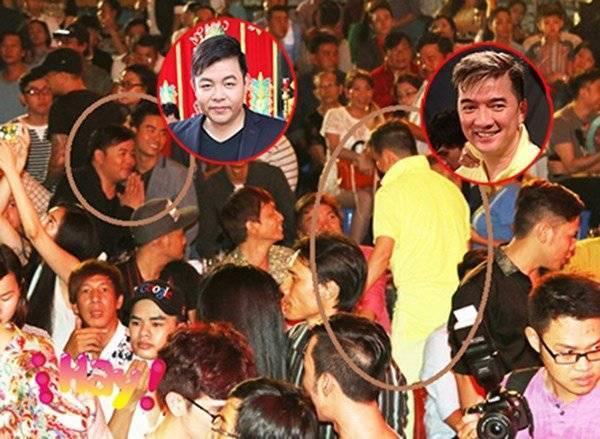 Quang Lê và Đàm Vĩnh Hưng giáp mặt giữa đám đông và bắt tay chào hỏi trước sự chứng kiến của nhiều người. Ảnh: Thanhnien