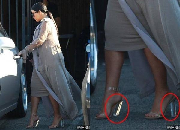 Phần gót giày nghiêng ngả vì trọng lượng của Kim.