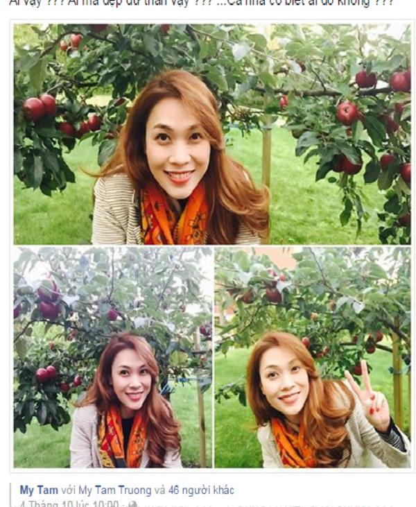 Mỹ Tâm chụp ảnh bên cây táo.
