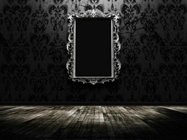 a beautiful vintage mirror in a dark room