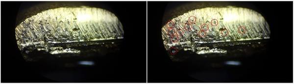 Hạt nhỏ màu trắng khi soi dưới kính hiển vi. Kết quả đo cho thấy có sự khác biệt khá rõ giữa mặt ngoài và bên trong mẫu vàng. Sự chênh lệch này làm cho người mua bị thiệt hại nếu không xác định được chính xác hàm lượng của vàng trong mẫu.