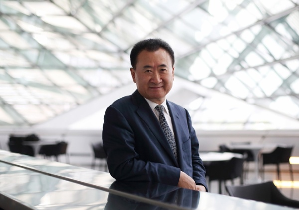 Billionaire Wang Jianlin, chairman and president of Dalian Wanda Group, poses for a portrait at the World Economic Forum Annual Meeting Of The New Champions in Dalian, China, on Wednesday, Sept. 11, 2013. Wang, China's richest man and owner of the country's biggest commercial land developer, said he has hired two investment banks to buy hotel management companies, mostly in the U.S. Photographer: Tomohiro Ohsumi/Bloomberg *** Local Caption *** Wang Jianlin