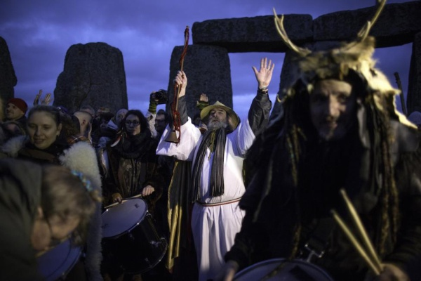 Revelers celebrate the winter solstice at Stonehenge on Salisbury Plain in southern England December 22, 2015. REUTERS/Kieran Doherty