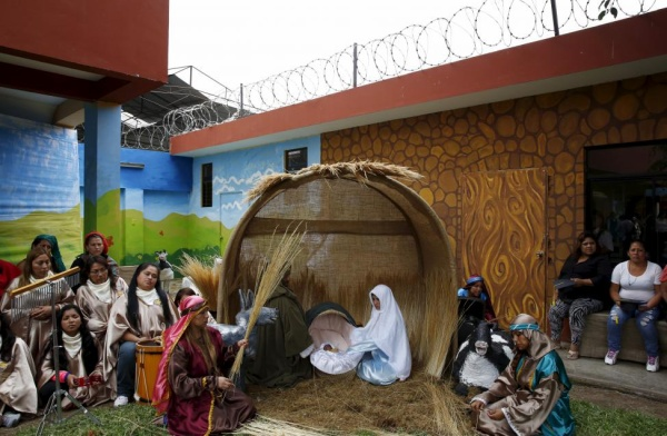 Inmates in costumes perform the birth of Jesus ahead of Christmas at Sarita Monica female prison in Lima, Peru, December 21, 2015. At the event inmates stage the birth of Jesus and celebrated the end of the school year for children. Inmates who are mothers are permitted to have their children stay in prison with them till they are 3 years old. Forty-four children live together with their mothers inside the prison, according to the press released by the Penitentiary Institute. REUTERS/Mariana Bazo