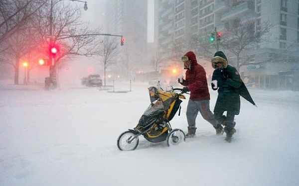 3 jonas Sean Jackson and Gina Del Tatto push their child, Hayes Jackson, in a stroller as heavy snow falls in New York's Upper West Side