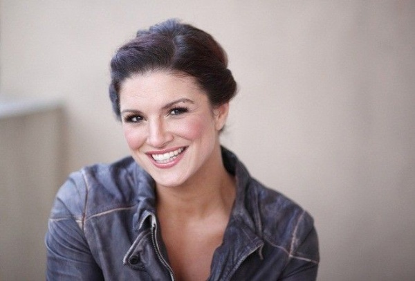 "Mixed Martial Arts (MMA) fighter and actress Gina Carano poses for a portrait while promoting the film ""Haywire"" in Beverly Hills, California, January 7, 2012. REUTERS/Danny Moloshok (UNITED STATES - Tags: ENTERTAINMENT SPORT) - RTR2W0L4"