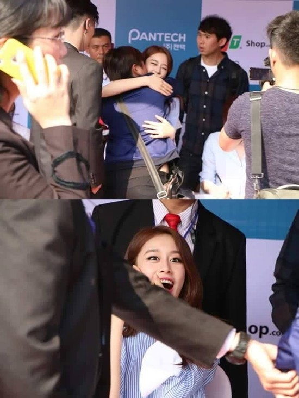 JiYeon bất ngờ khi bị một người hâm mộ hôn vào má trong buổi ký tặng.