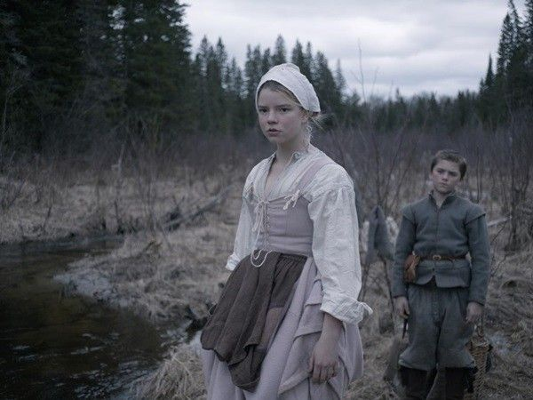 "This photo provided by courtesy of A24 shows Anya Taylor-Joy, left, as Thomasin, and Harvey Scrimshaw as Caleb in a scene from the film, ""The Witch."" (Rafy/A24 via AP)"