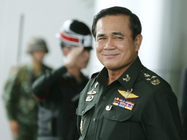 epa04253152 Thai army chief and junta head General Prayuth Chan-ocha smile as he leave after the meeting of the 2015 national budget at the Army Club in Bangkok, Thailand, 13 June 2014. Thailand's army chief General Prayuth Chan-ocha seized power with a coup d'etat on 22 May 2014 and placed the country under martial law. He said an interim government is expected to be formed within the next three months after he seized power on 22 May, saying the coup was necessary to restore order after more than six months of street protests resulting in terrorist attacks and a political gridlock. He vowed to appoint a prime minister once peace is restored, to enact political reforms and hold elections within about 15 months. EPA/NARONG SANGNAK