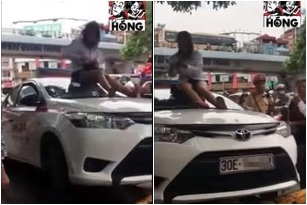 Bị CSGT dừng xe vì vượt đèn đỏ, nữ tài xế chửi bới rồi trèo lên nóc ôtô ăn vạ